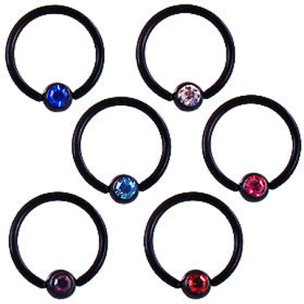 Intimpiercing Frau schwarz Ring mit Glitzer